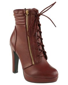 Steal the scene with the Vela2 Lace Up Platform Boot by Miss Black. In a muted shade ofburgundy, this tall beauty has grungy appeal thanks to the zipper and lace-up front, while the chunky heels add undeniable sexiness to their look. Choosethese boots to finish off an ensemble of grey skinny jeans, a sheer blouse anda burgundy gilet of faux fur.
