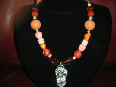 """Vintage beads on a med length necklace with 1 1/2 """" abalone shell flip flop charm!  winnieandbelle Made in U.S.A."""