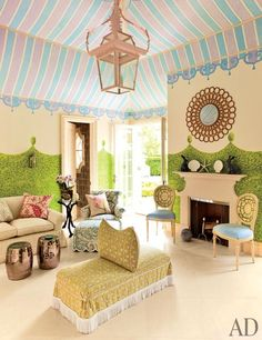 Mario Buatta ~ The playroom's ceiling and walls are by Atabeigi; the hanging lantern is by John Rosselli & Assoc., and the pillow-back ottoman in the foreground is upholstered in a fabric from Lee Jofa.