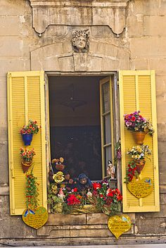 France, Arles, yellow shutters