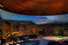emppeliaukio Church (Finnish: Temppeliaukion kirkko, Swedish: Tempelplatsens kyrka) is a Lutheran church in the Töölö neighborhood of Helsinki. The church was designed by architects and brothers Timo and Tuomo Suomalainen and opened in HELSINKI. Amritsar, Sacred Architecture, Modern Architecture, Abu Dhabi, Temple Square, Church Building, Place Of Worship, Kirchen, Granite