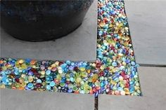 Colored glass Instead of gravel in the garden or patio...you can get these at the dollar store.  - Adventure Ideaz