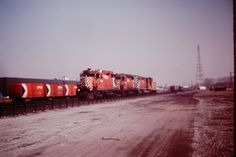 west bound CP caboose hop, behind CP GP35's 5004 and 5019 along with SD40-2 5749 at Leaside, Ontario on March 17, 1979.