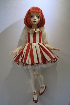 She is so cool! I love the creepy vibe, and the wooden ball joints with the porcelain body. Fantastic job!!!