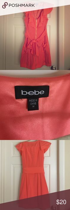 """Bebe dress Salmon colored Bebe dress. Size Medium. Was worn out for a birthday celebration. Has been dry cleaned and not worn since! Zips up the front. Super super body flattering. Pushes up boobs and sucks in waist! Also, I'm 5'7"""", to give you an idea of the length (see pic) bebe Dresses Mini"""