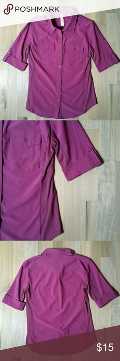"""Lucy Activewear Purple Button Up Top Size Medium Lucy Activewear  Purple Color  Button Front Closures  2 Front Pockets Roll Tab Sleeves Jersey Knit Side Panels 86% Polyester, 14% Spandex  Measurements: Shoulders: 17"""" Chest: 18"""" Length: 25"""" Lucy Tops Tees - Short Sleeve"""