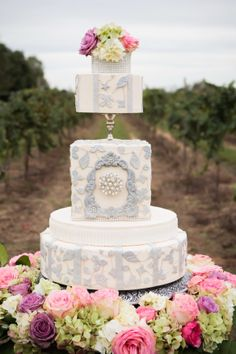 Wedding Cake by Mishelle Handy. D'Plazzo designed this vineyard dinner party at Rosebrook Vineyards. Flowers - Tony Foss, Photo - Colorband Photography.