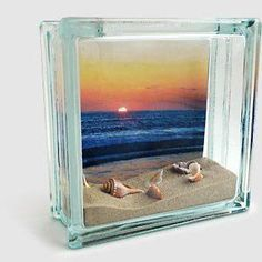 Photo Fillable glass block found at craft stores Ruler Scissors Sand and Seashells, or other vacation mementos How to Make it: Print your pictures on the KODAK Picture Kiosk. Trim photo to fit inside block. Secure top of photo to inside of bl Seashell Projects, Seashell Crafts, Beach Crafts, Fun Crafts, Arts And Crafts, Crafts With Seashells, Wood Crafts, Kodak Pictures, Glass Block Crafts