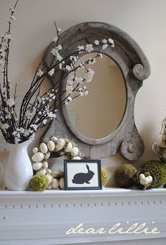 Old raw wooden oval mirror, bunny rabbit silhouette, blooms on branches in an ironstone pitcher, neutral egg wreath, moss balls - perfect mantle for Easter