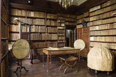 The Library at Ham House, Surrey constructed in 1672-4, with the terrestrial and celestial globes c.1746, here covered, and mahogany pole-screens on tripod stands with circular glazed maps.
