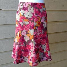 NWT Old Navy Floral Skirt This piece is NWT. Never worn Old Navy floral skirt size 10. It hits just below the waist as the tags indicate. Small marking on tag. It has a zipper and clasp in the back which both work. It has structural lines throughout to make it straighter at the hip and more flowy at the bottom. The waist is 32 inches. The length of the skirt is 22 inches. Shell 100% polyester. Lining 100% polyester. Old Navy Skirts Midi