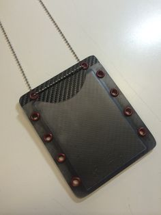 Credential Holder in black carbon fiber and red hardware from Aspis Tactical Solutions.  #tacticool  #kydex
