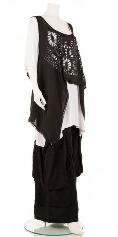 Fabulous striking asymmetric style overlay top from the new season Mat Fashion summer collection 2014. Wonderful  lattice cut-out design  and pretty lace trim. A versatile summer wardrobe piece. Visit our webstore www.idaretobe.com