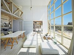 A simple geometric bayfront home in Chile photos by: Roland Halbe