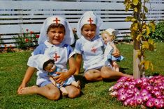 Vintage photo of little girls' playing nurse with their dolls, 1960's.