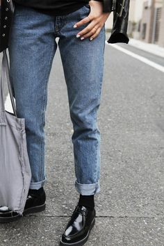 Denim Jeans rolled up with black shoes. Fab
