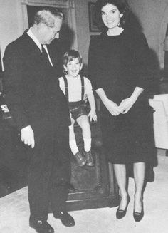 Chief Usher J.B. West, Jackie Kennedy and John, Jr. on their last day in the White House.