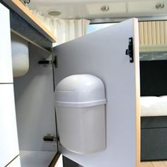 The Camco 43961 Wall Mount RV Trash Can is compact and perfect for tight spaces in your RV, camper, or boat. It features a swing-top lid and is easy to install.