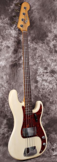 1966 Fender Precision Bass - Olympic White - 1 pickup, 1 volume control, 1 tone control - what else do you need? 50 years old next year.