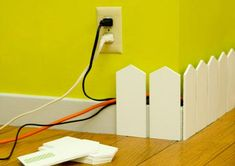 Baseboard Picket Fence for cord management. Might be a cool idea to hide cords from the younger toddlers.