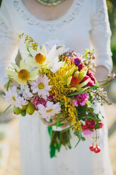 bright wedding bouquet with yellow and pink // photo by Amber Vickery // flowers by Rosehip Flora
