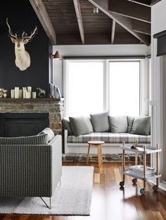 The Mt Buller home of Andrew and Tiffany Percy and family. Living room details – custom plaid banquette seat, Studio Ilse Crawford side table, custom plaid sofa, wool rug from Halcyon Lake, and Normann Copenhagen trolley. Photo – Eve Wilson for thedesignfiles.net