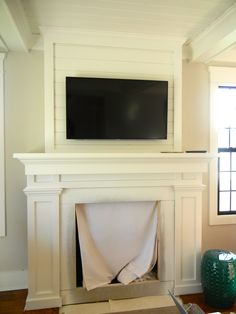 custom built fireplace mantel and beamed ceilings