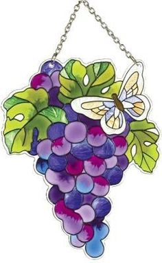 Grapes Sun Catcher by Joan Baker Designs. $18.95. Made of glass. 5.25 x 7 inches. Lushly colored. These fruits of the vine are so lushly colored, they seem like you could reach out and pick them for your lunch. But we think you'll enjoy them much more if you leave this grape sun catcher hanging where the sun or artificial light can take the intensely colored glass and turn it into a burst of purple. Terrific accent for rooms with Tuscan décor or wine themed accen...