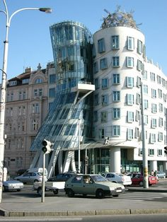 The Dancing House, Prague, Czech Republic - A controversial concept at the time, the building, which was designed by Vlado Milunić, is an homage to Fred Astaire and Ginger Rogers and was formerly called 'Fred and Ginger'. The building looks oddly warped as it represents the two actors dancing. It is also known as 'The Drunk House' and has become an attraction due to its strangeness and stark contrast to the old and stunning buildings of Prague.