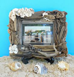 "Driftwood Frame, Ocean driftwood Picture Frame, Oyster and Shell Clusters, Florida Coast Driftwood, 12"" x 9.5"", 5 x 7 photo and Matted by BytheSeawithPolly on Etsy https://www.etsy.com/listing/224796474/driftwood-frame-ocean-driftwood-picture"