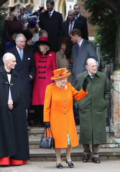 The Queen stood out in the crowd in her bright orange coat as she waved to well-wishers wh...