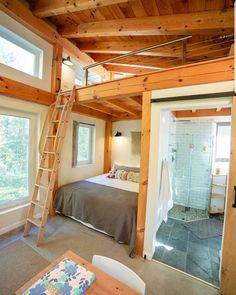 This tiny timber frame home by has a great modern feel with the right amount of real wood accents.