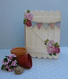 Cute gate idea Handmade garden-themed mini album ideal to hold seed packets. Made from lollipop sticks for a textured feel. Lolly Stick Craft, Popsicle Stick Crafts, Craft Stick Crafts, Crafts For Kids, Popsicle Sticks, Karten Diy, Stick Art, Shaped Cards, Fairy Doors