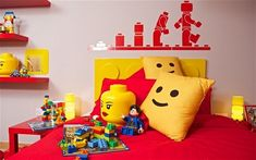 lego theme room, yellow pocket pillows with lego man face stenciled on.