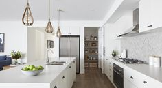is the perfect choice when designing a Hamptons kitchen; reflecting light to achieve the elegant coastal feel we love about this style of design. The Marseille Display Home at Clydevale, is a modern interpretation of Hamptons. Hamptons Style Homes, Hamptons Decor, Boutique Interior, Boutique Homes, Hamptons Kitchen, Display Homes, Beach House Decor, Home Decor, Dream House Plans