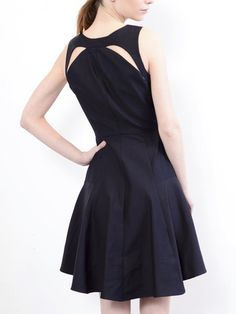 Black tennis dress with cut out back by Daniella Kallmeyer. I feel like I could step from exercising right into a formal setting and still be fashionable.