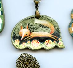 Fox necklace by Elsa Mora, one of my favorite artists right now.  Click on link for nine more beautiful, wearable, works of art.
