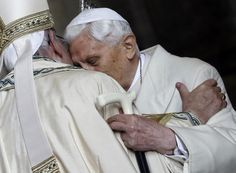 Pope Emeritus Benedict XVI greets Pope Francis in St. Peter's Basilica at start of the Holy Year, Dec. 8, 2015.  (AP Photo/Gregorio Borgia)