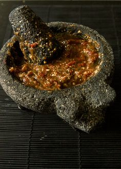 Salsa de Molcajete: Mexican hand ground roasted tomato and chilli salsa. The Molcajete is a traditional pestle and mortar.