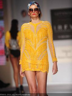 A model showcases a creation by designers  Shane and Falguni Peacock during India Resortwear Fashion Week 2013, held at JW Marriott, in Mumbai.