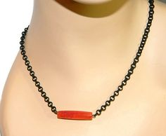Beautiful double link chain in black. Balanced with a red agate onyx column bead. (34x8mm) Also known as Blood Agate. This is a fantastic