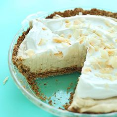 10-ingredient vegan coconut cream pie with naturally-sweetened oat-almond crust, coconut pudding filling, topped with fluffy coconut whipped cream!