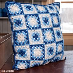 White and blue granny square cushion