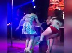 Defendiendo su lugar. Mujer celosa pelea con stripper.
