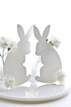 Cotton... umm.. carnation tail bunny silhouettes. Good for table menus or decor. Or a nice template for upcoming Easter cards.