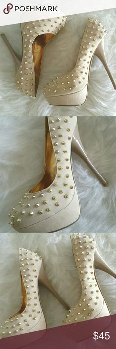 Platform Beige spiked pumps New with box Beige suede sexy pumps w/gold spikes! Sold out everywhere! Designer style for a great price!  Message me with any questions xo POSH Shoes Heels