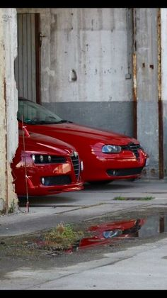 Alfa Brera S and a late model 156. Racing history built into their demeanor