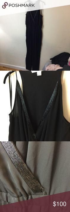 DVF Black Shany Beaded Embellished Pant Jumpsuit DVF Jumpsuit with a couple beads missing at the corner pictured- otherwise super cute and is a size 8. Authentic and sexy - made of silk and is Sleeveless. Wear this baby out on the town!! Diane Von Furstenberg Pants Jumpsuits & Rompers