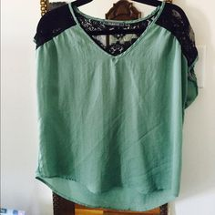 Short sleeve mint green chiffon/lace top Short sleeve mint green chiffon top with black lace. V-neck neckline, loose fit, great condition. Peppermint Tops