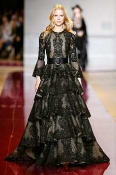 Zuhair Murad | This is an Insanely Romantic Black Embellished Lace Dress. It has a Fitted Lace Bodice, Bell Sleeves and Tiers and Tears of Exquisite Lace that make up the Opulent Skirt. Your Diamonds don't compete with the Lace. They're Simple and Big - except for the Bracelets in Lacy Diamond Pave. I've got Guipur Lace Pumps and a Lacey Crystal Clutch (It's all on this board). This is your evening of High Romance. - Gabrielle
